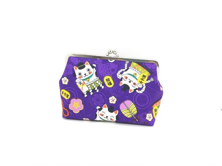 lila violette Clipbörse mit Winkekatzen